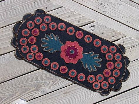 Pink and black penny rug